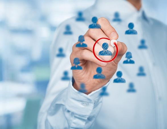 Marketing segmentation and targeting, personalization, individual customer care (service), CRM and leader concepts. Human resources officer select one person, office out of focus in background, wide (banner) composition.
